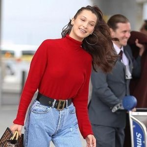 Bella Hadid Red Top Ripped Jeans Airport Look